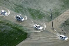 August 29, 2008  Pictures of the Day - Photo Journal - WSJ Cars traveled down a flooded street between fields in Okazaki, Japan, Friday. Heavy rain flooded hundreds of homes in central Japan Friday, leaving one elderly woman dead and prompting evacuation orders for more than 500,000 households. (Photo: Reuters)