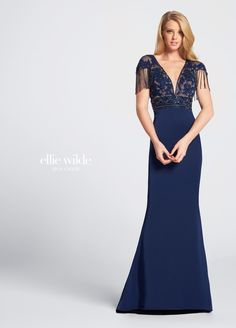 Ellie Wilde EW21718 - Cap sleeve beaded evening gown. Stretch crepe and tulle fit and flare gown with lace illusion cap sleeves trimmed with hand-beaded fringe, beaded deep plunging V-neckline with illusion modesty panel, beaded lace illusion bodice with beaded empire waistband, beaded lace illusion back with matching fringe.