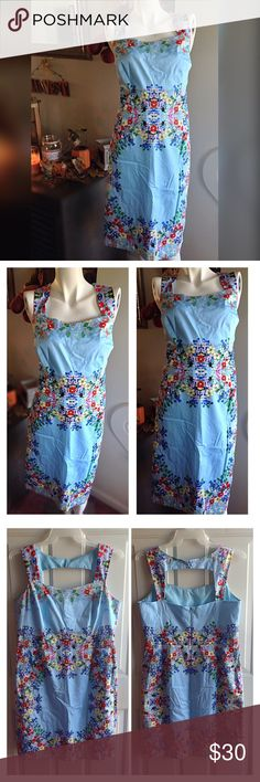 Blue skies take me away... Beautiful Blue dress with flower detailing. Vintage feel. Gently worn like new. Worn once for a baby shower. Zipper in the back along with cute cut out detailing. Size chart and measurements in last photo. roz & ali Dresses