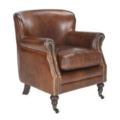 The Bridge vintage leather armchair is small sized club chair hand-crafted from premium quality vintage top grain leather and features turned wooden legs and castors. Its traditional shape means this chair would look stunning in smaller room or in the bed Vintage Leather Sofa, Leather Club Chairs, Leather Furniture, Leather Armchairs, Distressed Leather, Brown Leather, Wooden Dining Room Chairs, Living Room Chairs, Online Furniture
