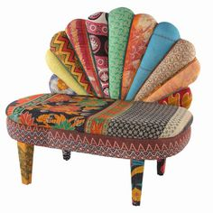 Scallop-back settee made from vintage saris and a wood frame.   Product: ChairConstruction Material: Wood and cotton...