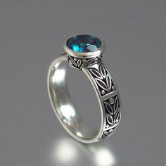 I adore this ring! http://www.etsy.com/listing/101522188/laurel-crown-silver-ring-with-london