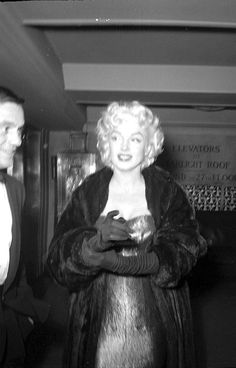 Marilyn and Milton Greene arriving at the Friar's Club Testimonial Dinner at the Waldorf Astoria, New York, March 11th 1955.