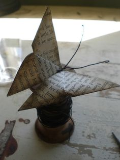 up-cycled book binding origami art (see source for additional paper-based decor)
