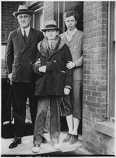 Franklin D. Roosevelt with Eleanor Roosevelt and son John, in 1930.
