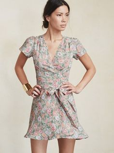 This one's just so easy. The Penny Dress is a fit and flare, crepe mini dress with gathered cap sleeves, V neck, and a wrap skirt. Adjustable tie at the waist, so you can make sure it feels right.   Made from 100% viscose.