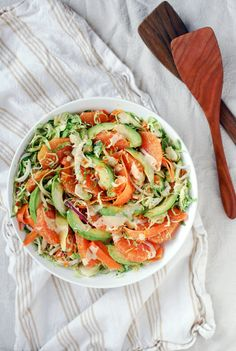 shaved brussels sprout and carrot salad with cara cara, avocado, and orange tahini dressing