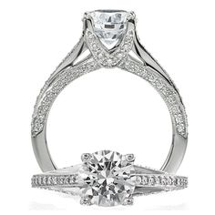 Modern diamond engagement ring featuring a prong set round brilliant cut diamond centerstone with a micropavé V design on the undergallery.  Finishing this piece is the single row micropavé shank with side micropavé accents.