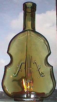 Antique Figural VIOLIN or CELLO shaped BOTTLE - Early hand blown example - Beautiful Golden Yellow Bronze color.. $50.00, via Etsy.