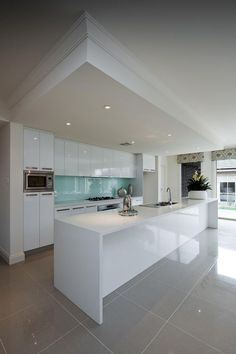 Love The Dropped Ceiling, Blue Glass Splashback And Tonnes Of Cupboards. 32 Modern  Kitchen Decoration With Grey Floor ...