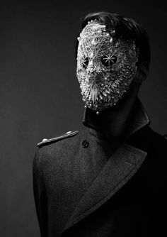 The bejewelled masks worn by the Psi-clerks are believed to enhance their mental powers, and at the same time shield their minds from others.