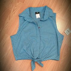 Plaid Blue Top Blue/ White Plaid top with knot. Never worn.  55% Cotton 45% Polyester Anxiety Tops