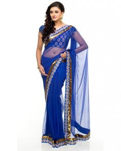 A royal blue Net saree featuring a double border of Gota and Matt Gold Lurex. To add to the traditional look of this saree, it comes wth a brocade blouse featuring short puff sleeves. Perfect for a pooja, adorn this saree during any traditional function. The saree is complete with fall and finish.#Ootd #Potd #Qotd #Fashion #Shopping #WomenWear #IndianWear #Style
