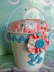 Bucket pincushion.  Just got the cutest button one over Christmas.  The perfect use for it.