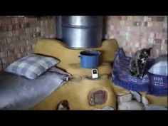 Living with the Rocket Mass Heater, cleaning, lighting, splitting fuel - YouTube