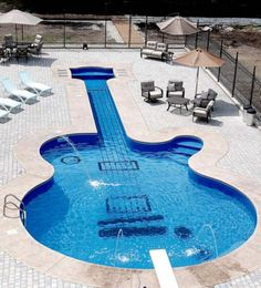 This amazing swimming pool shaped like a guitar proved to be a challenge for its designers and builders – Canadian Aqua-Tech Company. Their client, a passionate guitar collector who walked in their office looking for a hot tub, had a sudden change of heart and approached them with an odd, yet interesting idea. Wanting a guitar-shaped swimming pool in his backyard, the client was presented with an exact replica of a Les Paul Custom guitar – shaped in fine details and exemplary displaying…