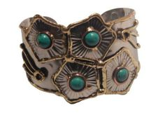 Accessory Accomplice Silver Mixed Metal Hammered Cuff Bracelet . $12.99. Silvertone Metal with flower detail outlined in gold with turquoise center outlined in bronze. Adjustable Cuff Measures 2 Inches High, 8 inches Around The Wrist. Complimentary Gift Box