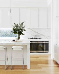 Scene-stealing marble is the hero in this stunning Hamptons-style kitchen, paired perfectly with classic, panelled cabinetry to complete… Home Decor Kitchen, Replacing Kitchen Countertops, Contemporary Kitchen Cabinets, Interior Design Kitchen, Contemporary Kitchen, Hamptons Kitchen, Kitchen Styling, Kitchen Renovation, Kitchen Design