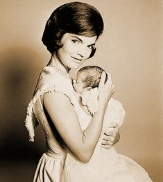 JACQUELINE BOUVIER KENNEDY AS SHE CARES FOR HER SON JOHN F. KENNEDY JR..collection the american heritage collection raleigh degeer amyx 