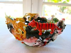 Learn how to make a fun upcycled plastic animal toy bowl...a great way to reuse all those discarded kid knickknacks!