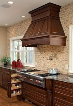 Love this vent hood and the decorative millwork beside the range