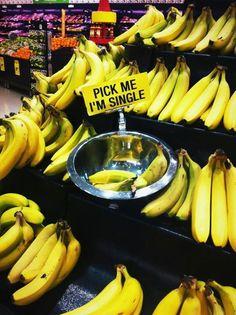 Pick me. Bananas at the supermarket.