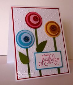 Don't you just love simple? I love this retro look lately. It just makes me happy! How about you? If you have a variety of circle punches & card stock colors, you've got most of what you need to make this card. I hand cut the stems & leaves & used a dimensional between the second & third circle layers. This card is another example of using a variety of colors of card stock but only one ink color. So...