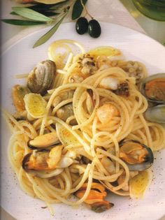 Spaghetti with clams and squid is delicious Italian recipe.Cooked spaghetti with seafood and white vermouth is and excellent Italian combination!