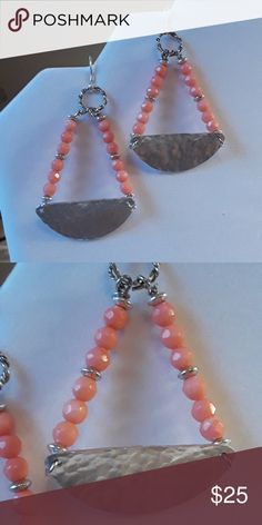 """NWT new Hammered half circles and coral Earrings New with tag (optional) and gift box included with purchase. These trendy beauties are made with 1/2 mm genuine coral beads. The color of the faceted beads are so pretty. The hammered metal gives an edge and tribal character to this piece. The earrings drop a bit over 2"""". And the earring hooks are .925 sterling silver. Wear these with a dress or a casual outfit. They are versatile for your wardrobe. Buy one, I give 10% to charity. Greendell…"""