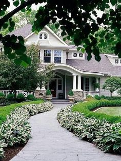 Curb appeal ~ Edge your pathway with low, eye-catching plantings leading to your front door