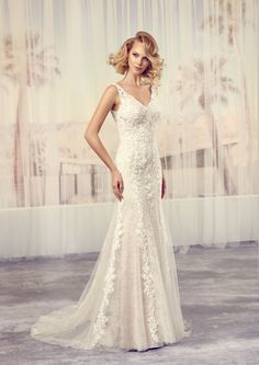 This dress is elegant and refined - an instant classic with its v-neckline in the low open back and front, soft A-line skirt, and beautiful embroided lace over tulle.