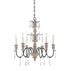 This exquisite chandelier has the timeless beauty of a french antique updated with a warm wood and iron finish, and crystal spear pendalogues. Designed by...