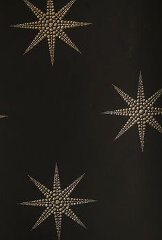 Pampille Wallpaper Black Wallpaper with gold diamante print stars.