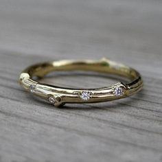 Looking for a unique engagement ring? Check out this twig-inspired style, dotted with diamond dewdrops — one of many unusual and enchanting options on #Etsy.