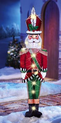 "Festive holiday figure features sparkling lights and lots of charm. Santa Claus is dressed as soldier to add some color and fun to any space. Plug into AC outlet. 36""L cord. Iron and plastic. 44""H. - See more at: http://www.collectionsetc.com/Product/lighted-santa-claus-holiday-stake-decoration--44.aspx/_/N-lfls#sthash.JIVYgM5D.dpuf"