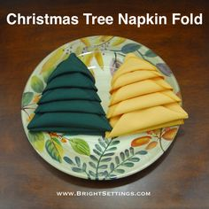 Christmas Tree Napkin Fold — You can add some Christmas jolly to your table with these step by step tutorials for learning how to make several styles of Christmas Tree Napkin Folds. #christmastree #napkinfold #napery