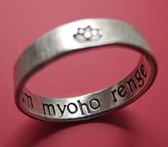 Keep your mantra with you always, tucked secretly inside this sweet sterling ring. A special little lotus flower decorates the exterior. Each ring is solid sterling silver, sized to your preference and stamped inside with 'nam myoho renge kyo' or your custom message. The 'nam myoho renge kyo' phrase is a Buddhist mantra chanted to …