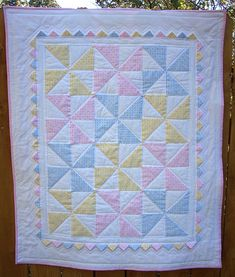 Pastel Pinwheel baby quilt Pastel pinwheel quilt with prairie points. I could totally do this. Didn't even think of how cute it would be in pastels. Quilt Baby, Baby Quilts Easy, Baby Patchwork Quilt, Baby Girl Quilts, Lap Quilts, Girls Quilts, Scrappy Quilts, Baby Quilt For Girls, Pinwheel Quilt Pattern