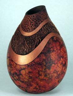 Stunning gourd art by Judy Richie.  The coloration and use of texture is spectacular.