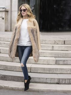 Olivia Palermo street style, black fringe boots, blue ripped jeans, white shirt, fur jacket