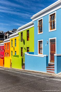 A row of rainbow colored houses in the Bo-Kaap in Cape Town, South Africa. Click… A row of rainbow colored Best Places To Travel, Places To Go, Places Around The World, Around The Worlds, Africa Painting, Africa Drawing, The Bo, Africa Destinations, Travel Destinations