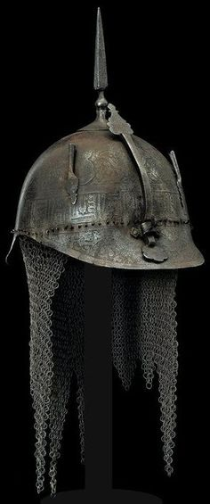 """Indo-Persian khula khud, 19th century,  the visor in the form of a European """"pickelhaube"""" helmet, the entire surface engraved with human figures, animals, floral designs and a band with inscriptions; cusp on round base, nasal protection, camail with butted links."""