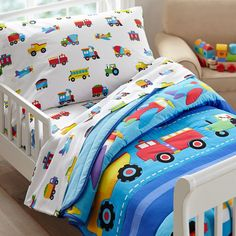 Trains, Planes & Trucks is an Olive Kids classic! The Trains, Planes, Trucks Toddler Comforter includes one comforter/quilt featuring a row of airplanes, assorted trucks and a train chugging along.