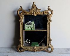 Vintage Shadowbox Mirrored Wall Shelves - kind of Alice in Wonderland....