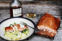 wood fired salmon on wood plank