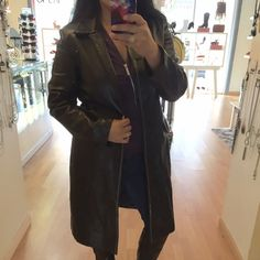"""Genuine black leather jacket by Margaret Godfrey Almost new leather jacket with a white stitching design! Size 12 and about 40"""" in length. 100% vinyl lining, and 100% genuine leather. Margaret Godfrey Jackets & Coats Trench Coats"""
