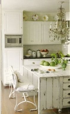 My dream home has a country farmhouse kitchen! I'd love a farmhouse sink, wide-blanked wood floors, open shelving, schoolhouse lamps, and a chandelier!