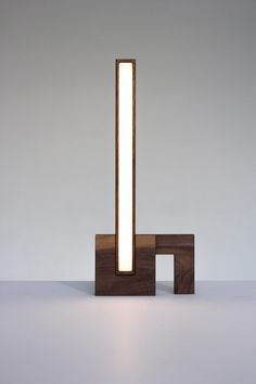 Whitney Robinson's Ess Lite is like a functional toy for big kids - its solid wood components fit together like puzzle pieces for endless light formations.