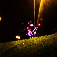 Fireworks on the bank as seen from the beach path #pathway #nikicottonartdotcom #fireworks #night