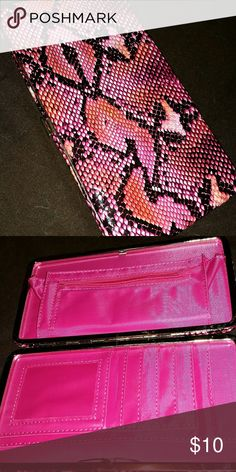 Faux snakeskin wallet Faux snakeskin. Pink, black & orange. Push-button opener. Snaps closed. Larger size, never used, sat in a box in storage. no brand Bags Wallets